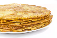 Pancakes. In plate on white background royalty free stock image