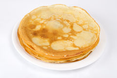Pancakes on a plate. On a white background Royalty Free Stock Images