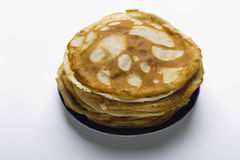 Pancakes on a plate on a white background Stock Photos
