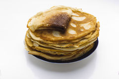 Pancakes on a plate on a white background Royalty Free Stock Photos
