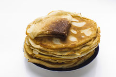 Pancakes on a plate on a white background Stock Images