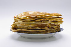Pancakes on a plate on a white background Stock Image