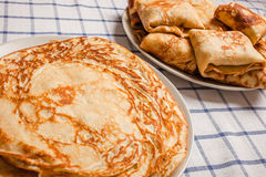 Pancakes on plates. Pancakes with stuffing on plates royalty free stock photo