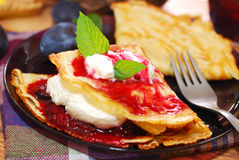 Pancakes with plum confiture and whipped cream Royalty Free Stock Photography