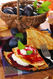 Pancakes with plum confiture and whipped cream Stock Image