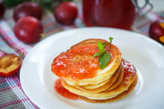Pancakes with plum jam Stock Images