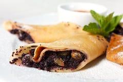 Pancakes with Poppy Seeds and Raisins close-up Stock Photos