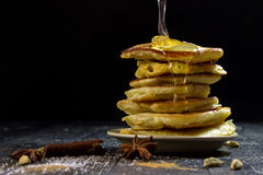 Pancakes with pouring honey on a black background Royalty Free Stock Images