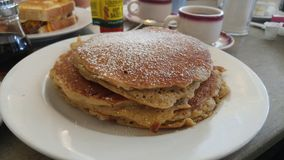 Pancakes. With powder at dinner Royalty Free Stock Image