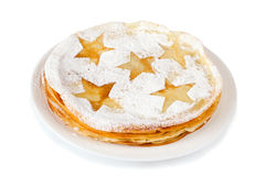 Pancakes with powdered sugar. On a plate on a white background Stock Photo