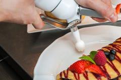 Pancakes preparing Stock Image