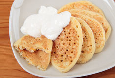 Pancakes with pumpkin and sour cream Stock Photography