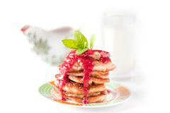 Pancakes with rasberry sauce. Sauceboat and milk Royalty Free Stock Images