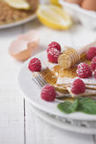 Pancakes & raspberries Stock Images
