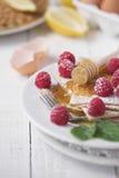 Pancakes & raspberries stock images