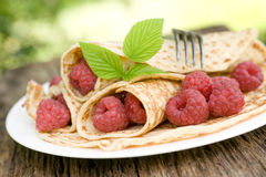 Pancakes with raspberries Stock Photo