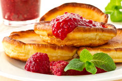 Pancakes with raspberries Stock Photos