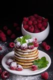 Pancakes with raspberries and berries around stock image