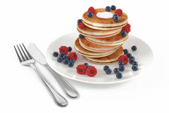 Pancakes with raspberries and blueberries Royalty Free Stock Photos