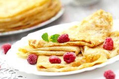 Pancakes with raspberries and butter Stock Image