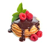 Pancakes with raspberries and chocolate sauce. Isolated on white background stock photos