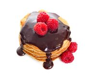 Pancakes with raspberries and chocolate sauce. Isolated on white background stock photography