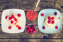Pancakes with raspberries and cream, raspberry nectarine jam Royalty Free Stock Photo