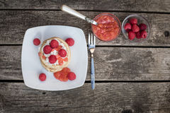 Pancakes with raspberries and cream, raspberry nectarine jam Stock Images