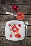 Pancakes with raspberries and cream, raspberry nectarine jam Stock Photography