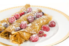 Pancakes with berries. Pancakes with raspberries and currants stock photo