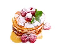 Pancakes with raspberries and honey or maple syrup. Isolated on white background stock images