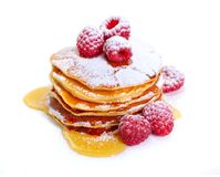 Pancakes with raspberries and honey or maple syrup. Isolated on white background royalty free stock photos
