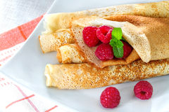 Pancakes with raspberries and mint Royalty Free Stock Photos