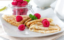 Pancakes with raspberries and mint Royalty Free Stock Images