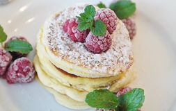 Pancakes with raspberries on top