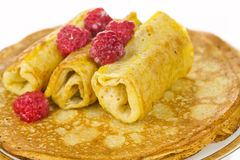 Pancakes. With raspberries on a white background stock photo