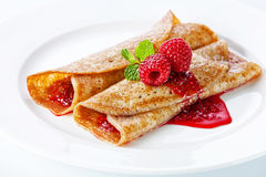Pancakes with raspberries Stock Images