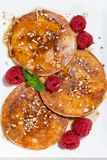 Pancakes with raspberries on white plate, closeup Stock Images