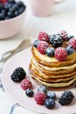 Pancakes with raspberry, blackberry ,blueberry on table. Side view Stock Photography