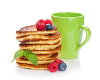 Pancakes with raspberry, blueberry and cup of drink Stock Images