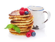 Pancakes with raspberry, blueberry and milk. Jug. Isolated on white background Stock Photography