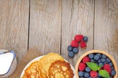 Pancakes with raspberry, blueberry and milk Stock Photo