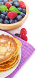 Pancakes with raspberry, blueberry, mint and honey syrup Stock Photos