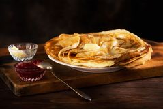 Pancakes with jam and butter Royalty Free Stock Photography