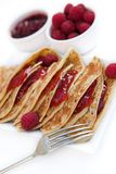 Pancakes with raspberry jam & fresh raspberries Stock Image