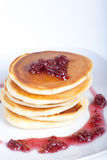 Pancakes with raspberry jam on a light background Stock Photography