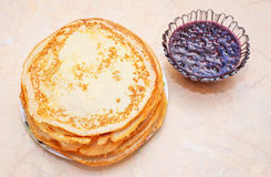 Pancakes with raspberry jam on the table. Royalty Free Stock Photo