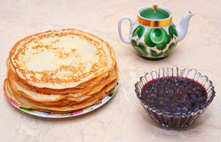 Pancakes with raspberry jam on the table. Royalty Free Stock Photos