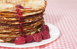 Pancakes with raspberry jam. Stock Photo
