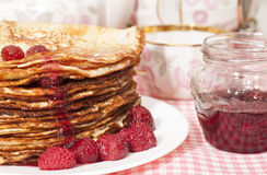 Pancakes with raspberry jam. Royalty Free Stock Photo